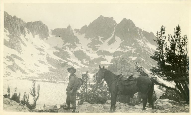 [High Sierra] Man and horse by lake [title supplied]. Gelatin silver print. ANONYMOUS PHOTOGRAPHER.