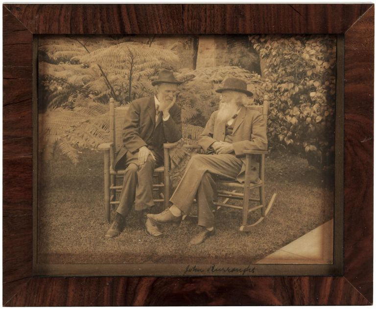 Photograph of John Muir and John Burroughs, signed in ink by Burroughs beneath the image on the mount. JOHN MUIR, JOHN BURROUGHS, subjects.