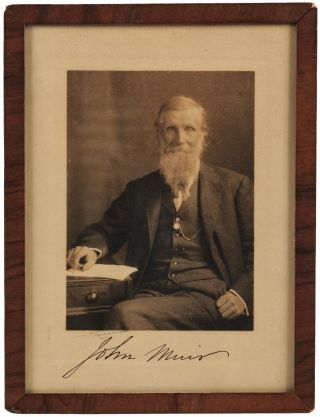 Photograph of John Muir, signed by him in ink beneath the image. JOHN MUIR, subject